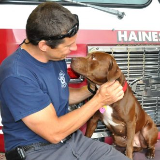 Fire department rescues, then adopts dog