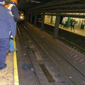 Blind man falls onto subway tracks, is saved by guide dog