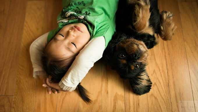 kid with puppy on floor