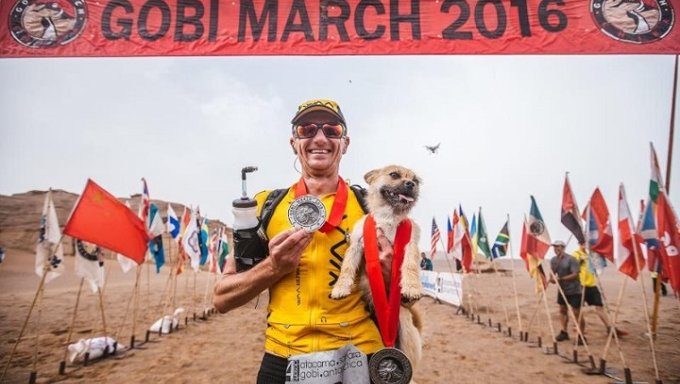 Gobi and Leonard at the finish line with medals