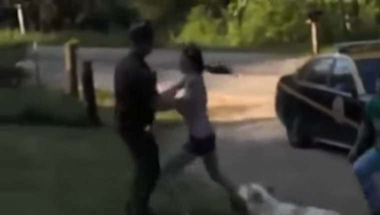 woman-arrested-stop-police-shooting-dog-2