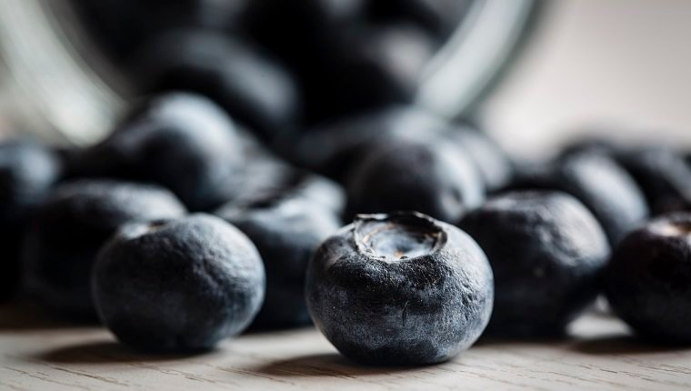 blueberries on white table, close up