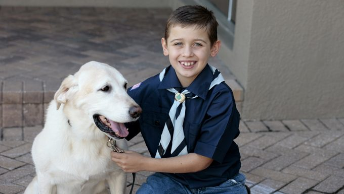cub scout boy with dog