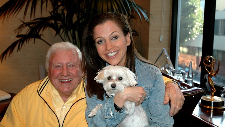 BEVERLY HILLS- JANUARY 12, 2005: Game show producer Merv Griffin poses with pet expert Wendy Diamond and her dog Lucky Diamond at his home in Beverly Hills, California on January 12, 2005. Griffin passed away August 12, 2007 at the age of 82 after a long battle with prostate cancer.